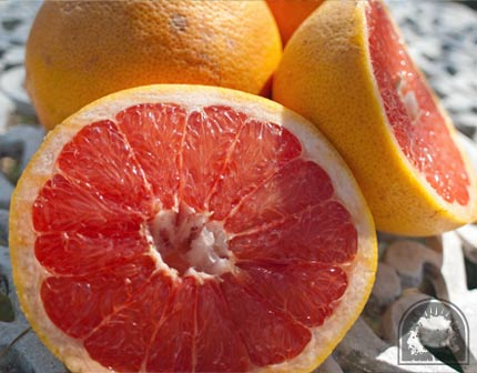 Sliced Rio Red Grapefruit on Table